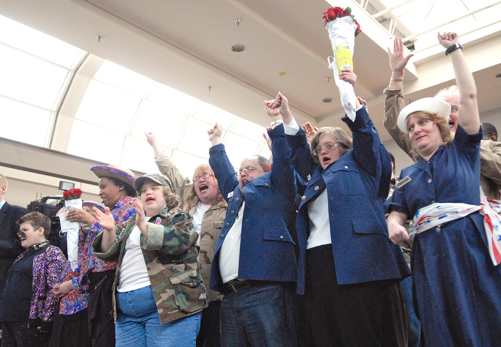 ". Jeff Forman/JForman@News-Herald.com Members of the ""All American Group\"" encore their performance of \""God Bless the USA\"" as they celebrate winning   Deepwood Idol March 29 at the Great Lakes Mall. The show was presented by the Lake County Board of Developmental Disabilities/Deepwood."