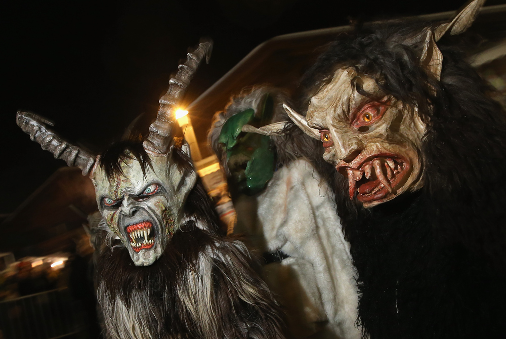 . Young children dressed as the Krampus creature walk the streets during Krampus night on November 30, 2013 in Neustift im Stubaital, Austria. Sixteen Krampus groups including over 200 Krampuses participated in the first annual Neustift event. Krampus, in Tyrol also called Tuifl, is a demon-like creature represented by a fearsome, hand-carved wooden mask with animal horns, a suit made from sheep or goat skin and large cow bells attached to the waist that the wearer rings by running or shaking his hips up and down. Krampus has been a part of Central European, alpine folklore going back at least a millennium, and since the 17th-century Krampus traditionally accompanies St. Nicholas and angels on the evening of December 5 to visit households to reward children that have been good while reprimanding those who have not. However, in the last few decades Tyrol in particular has seen the founding of numerous village Krampus associations with up to 100 members each and who parade without St. Nicholas at Krampus events throughout November and early December.  (Photo by Sean Gallup/Getty Images)