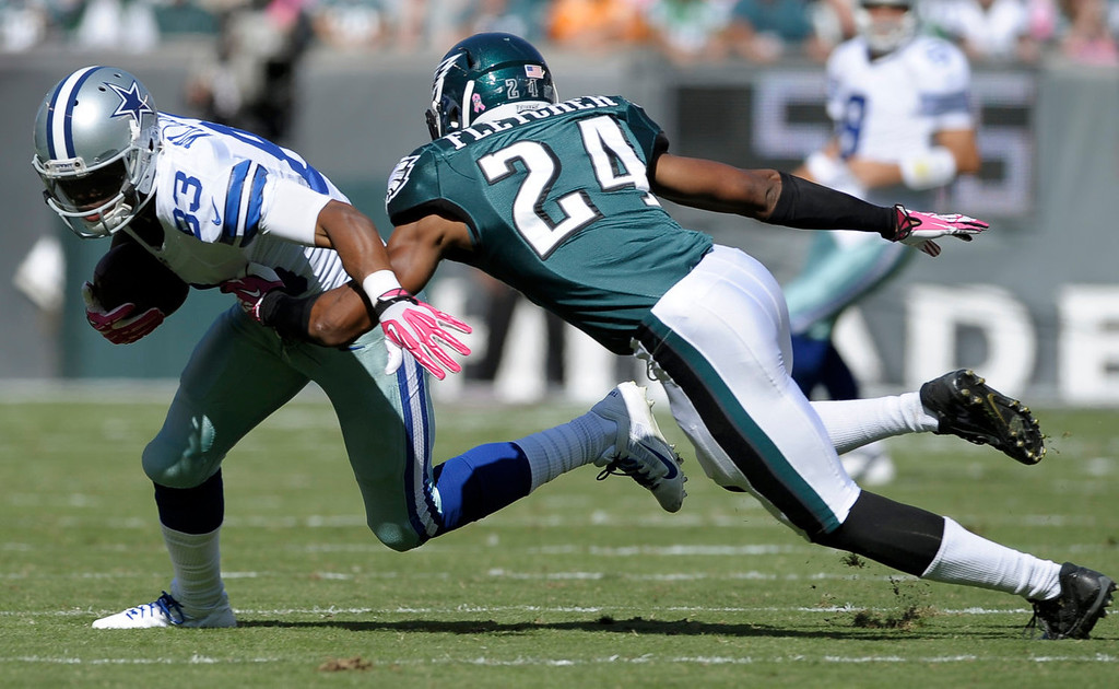 . Dallas Cowboys wide receiver Terrance Williams (83) runs after making a catch as Philadelphia Eagles cornerback Bradley Fletcher (24) defends during the first half of an NFL football game, Sunday, Oct. 20, 2013, in Philadelphia. (AP Photo/Michael Perez)