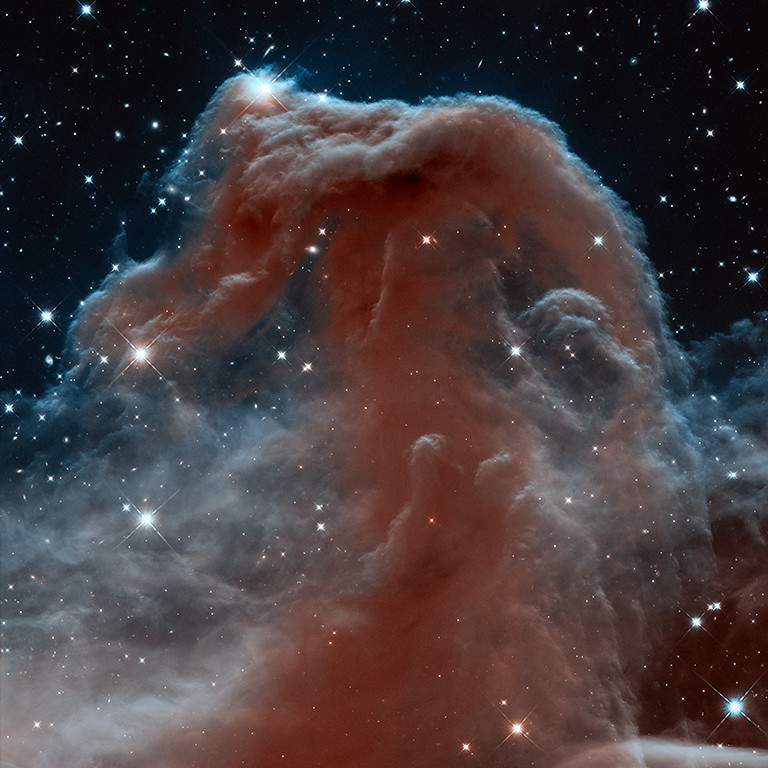 . 2013: Horsehead Nebula  Looking like an apparition rising from whitecaps of interstellar foam, the iconic Horsehead Nebula has graced astronomy books ever since its discovery over a century ago. The nebula is a favorite target for amateur and professional astronomers.  In this new Hubble Space Telescope view, the nebula appears in a new light, as seen in infrared wavelengths. The nebula, shadowy in optical light, appears transparent and ethereal when seen in the infrared, represented here with visible shades. The rich tapestry of the Horsehead Nebula pops out against the backdrop of Milky Way stars and distant galaxies that are easily seen in infrared light. Credit: NASA, ESA, and the Hubble Heritage Team (STScI/AURA)