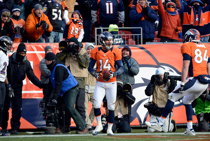 . Denver Broncos wide receiver Brandon Stokley (14) celebrates after scoring the Broncos second touchdown in the first quarter.  The Denver Broncos vs Baltimore Ravens AFC Divisional playoff game at Sports Authority Field Saturday January 12, 2013. (Photo by John Leyba,/The Denver Post)