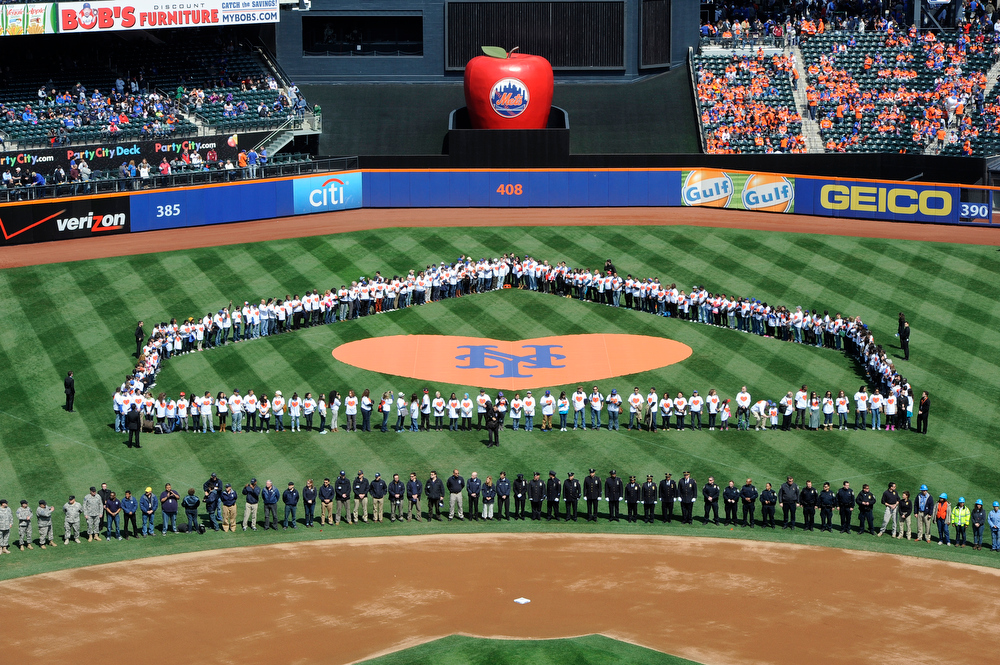 . First responders and volunteers who aided victims of Hurricane Sandy were honored on the field during Opening Day ceremonies before the baseball game between the New York Mets and the San Diego Padres at Citi Field on Monday, April 1, 2013 in New York. (AP Photo/Kathy Kmonicek)
