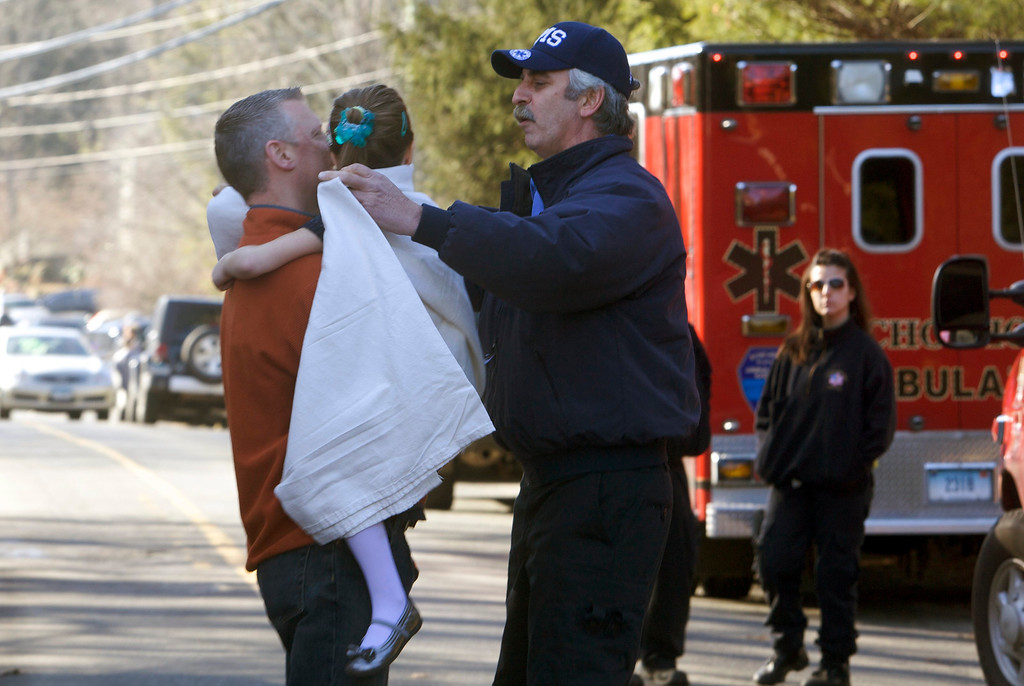. A young girl is given a blanket after being evacuated from Sandy Hook Elementary School following a shooting in Newtown, Connecticut, December 14, 2012. At least 27 people, including children, were killed on Friday when at least one shooter opened fire at the elementary school in Newtown, Connecticut, CBS News reported, citing unnamed officials. REUTERS/Michelle McLoughlin