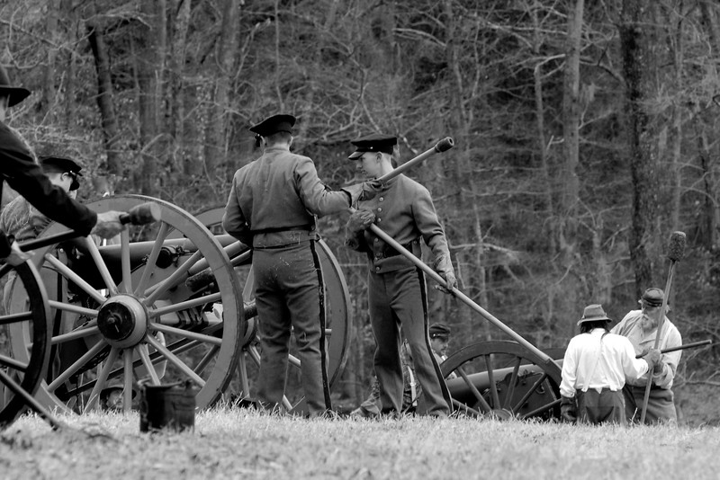 Reenactors for the Citadel prepare to fire a 6-pound Napoleon Canon. The Skirmish at Gamble's Hotel happened on March 5, 1885 when 500 federal soldiers, under the command of Reuben Williams of the 12th Indiana Infantry, marched into Florence to destroy the railroad depot but were met by Confederate soldiers backed up with 400 militia. The reenactment, held by the 23rd South Carolina Infantry, was held at the Rankin Plantation in Florence, South Carolina on Saturday, March 5, 2011. Photo Copyright 2011 Jason Barnette