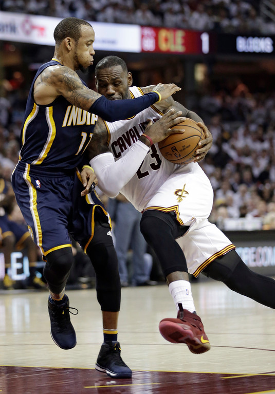 . Cleveland Cavaliers\' LeBron James (23) drives past Indiana Pacers\' Monta Ellis (11) in the first half in Game 1 of a first-round NBA basketball playoff series, Saturday, April 15, 2017, in Cleveland. The Cavaliers won 109-108. (AP Photo/Tony Dejak)