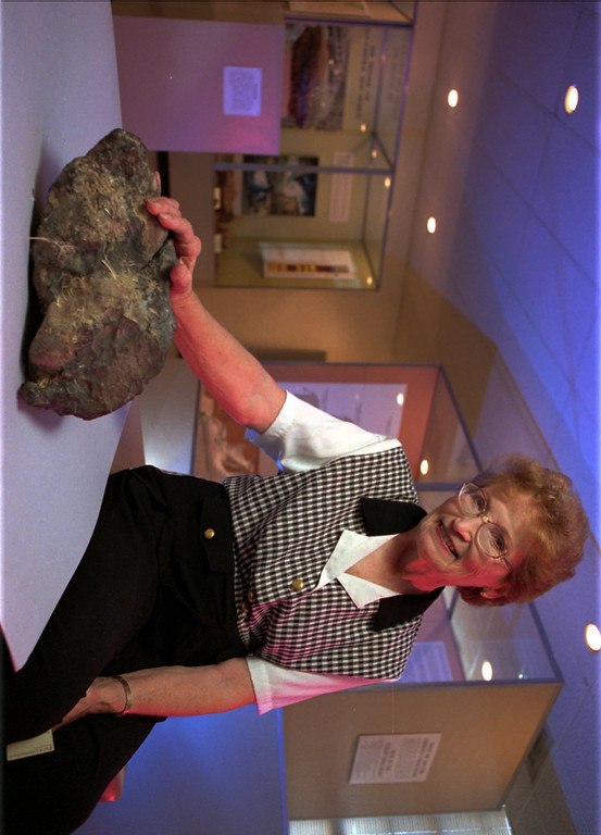 . Nelda Wallace of Portales, N.M., poses next to a 37-pound meteorite at the University of New Mexico in Albuquerque, N.M., Tuesday June 23, 1998, The meteorite, believed to be about 4.5 billion years old, landed in the back of her home early Saturday June 13, 1998.  University of New Mexico scientists say it\'s probably the largest meteorite ever to fall in New Mexico.  (AP Photo/Pat Vasquez-Cunningham)