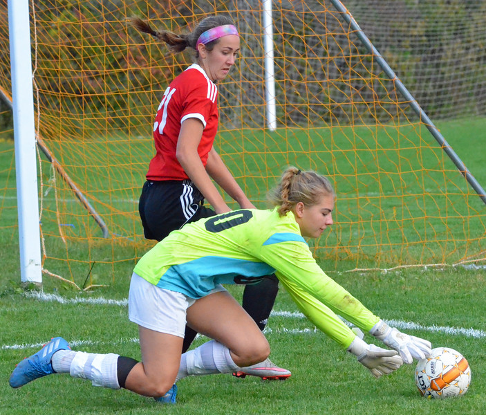 KYLE MENNIG - ONEIDA DAILY DISPATCH Oneida keeper Liz Rice dives on the ball in front of Vernon-Verona-Sherrill's Alexa Kiser (21) during their Section III Class B playoff match in Oneida on Tuesday, Oct. 18, 2016.