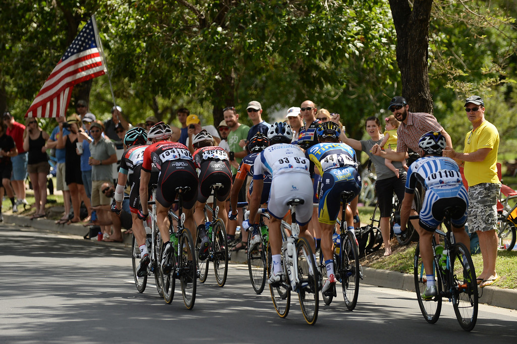 . People cheer on cyclists from the sidewalk of Speer Blvd. during the 75-mile 7th stage of the 2013 USA Pro Challenge race in Denver, Colorado on August 25, 2013. (Photo by Hyoung Chang/The Denver Post)