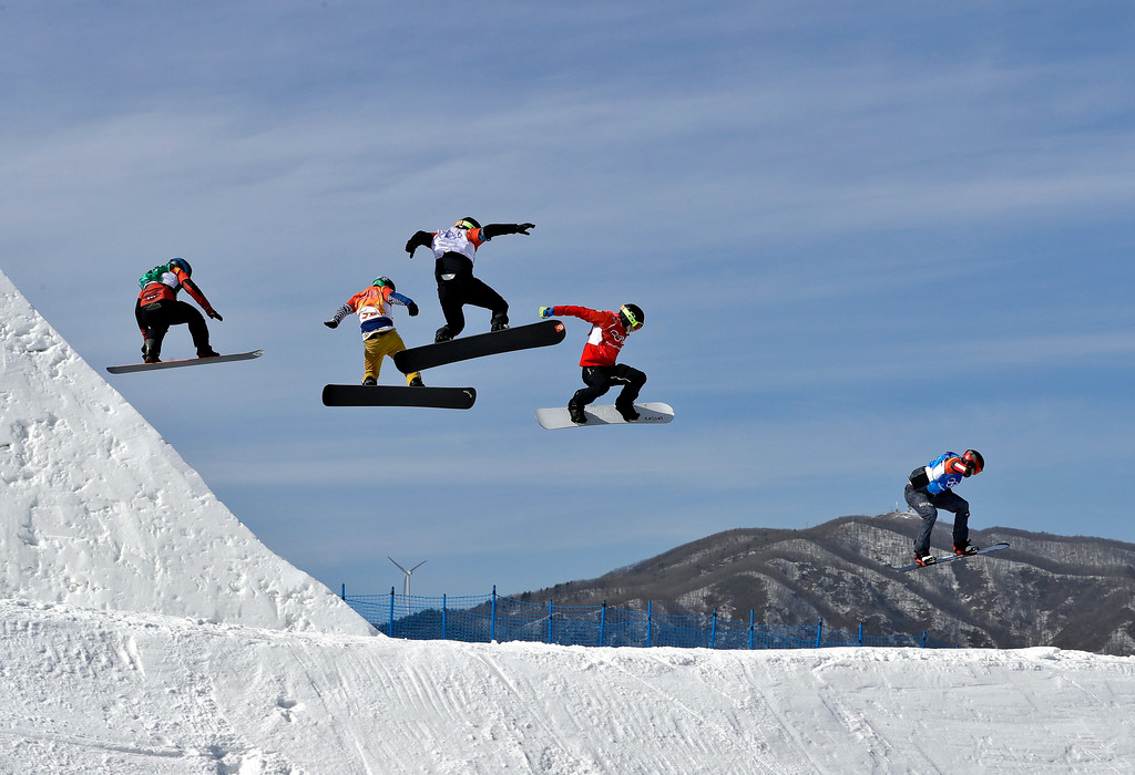 . Kalle Koblet, of Switzerland, Jan Kubicik, of the Czech Republic, Konstantin Schad, of Germany, Kevin Hill, of Canada, and Alessandro Haemmerle, of Austria, run the course during the men\'s snowboard cross elimination round at Phoenix Snow Park at the 2018 Winter Olympics in Pyeongchang, South Korea, Thursday, Feb. 15, 2018. (AP Photo/Kin Cheung)