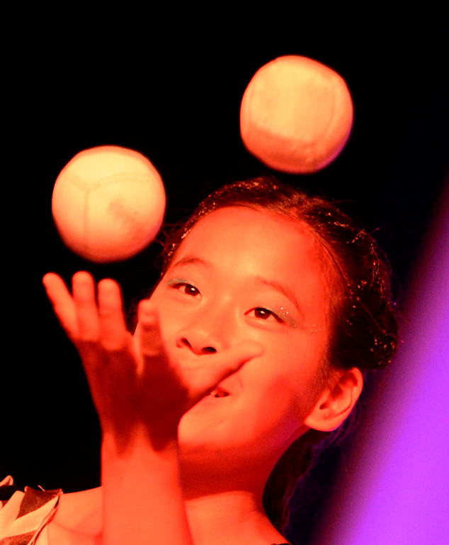 . A young girl juggles during the Great Y Circus in Redlands May 3, 2013.  GABRIEL LUIS ACOSTA/STAFF PHOTOGRAPHER.