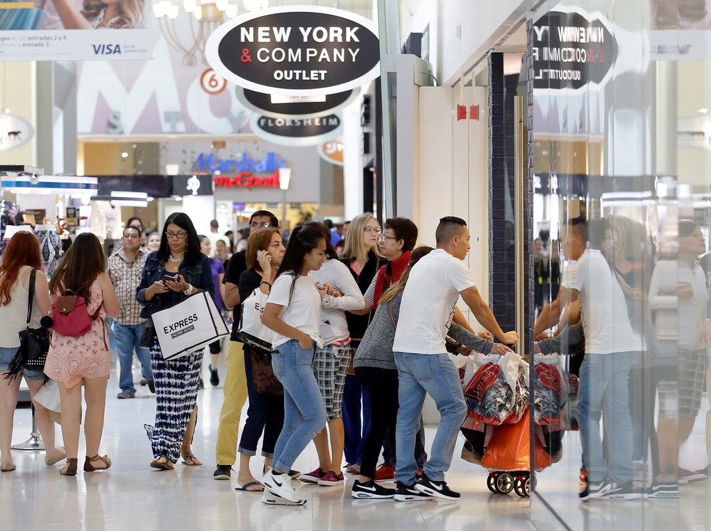 . Shoppers shop at the Dolphin Mall on Black Friday, Nov. 25, 2016, in Miami. Stores open their doors Friday for what is still one of the busiest days of the year, even as the start of the holiday season edges ever earlier. (AP Photo/Alan Diaz)