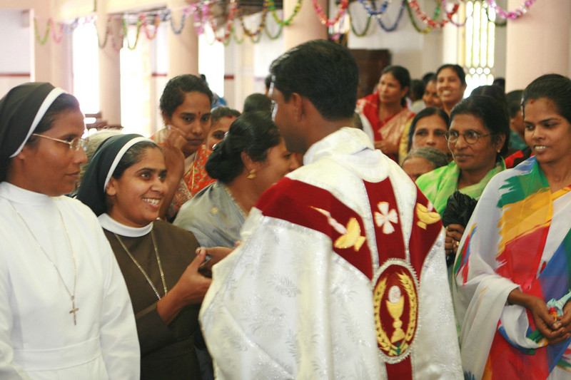 Fr. Thomas receives those who wish to offer congratulations.