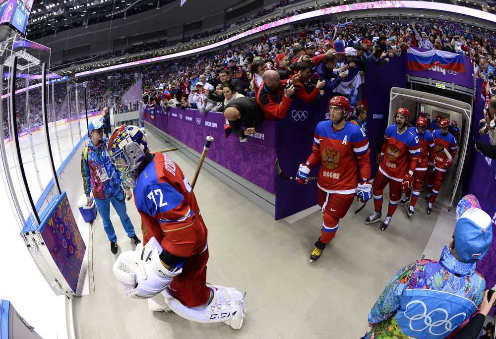 . Russia\'s players go on the ice prior to the Men\'s Ice Hockey play-offs qualification match Russia vs Norway at the Bolshoy Ice Dome during the Sochi Winter Olympics on February 18, 2014.  (JONATHAN NACKSTRAND/AFP/Getty Images)