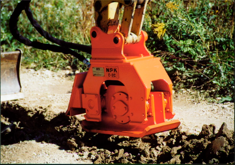 NPK C2C compactor with backfill blade on Cat mini excavator (13).JPG