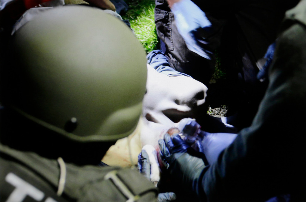 . In this Friday, April 19, 2013 Massachusetts State Police photo, tactical emergency medical technicians tend to 19-year-old Boston Marathon bombing suspect Dzhokhar Tsarnaev at the time of his capture by law enforcement authorities in Watertown, Mass. (AP Photo/Massachusetts State Police, Sean Murphy)