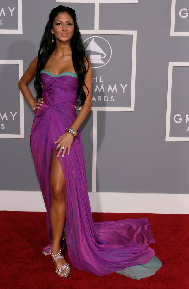 Description of . Nicole Scherzinger of the Pussy Cat Dolls arrives for the 49th Annual Grammy Awards on Sunday, Feb. 11, 2007, in Los Angeles.  (AP Photo/Matt Sayles)