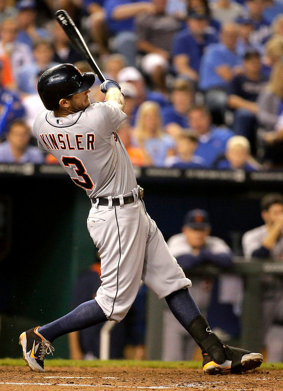 . Detroit Tigers\' Ian Kinsler follows through on a two-run home run during the fifth inning of a baseball game against the Kansas City Royals on Friday, Sept. 19, 2014, in Kansas City, Mo. (AP Photo/Charlie Riedel)