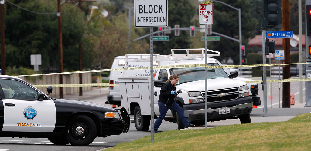 . A forensic officer walks at the scene where a man killed himself after a shooting spree through several cities, in Villa Park, California February 19, 2013. A gunman on a shooting spree in suburban southern California shot and killed three people and wounded two others on Tuesday before killing himself, police said.  REUTERS/Alex Gallardo