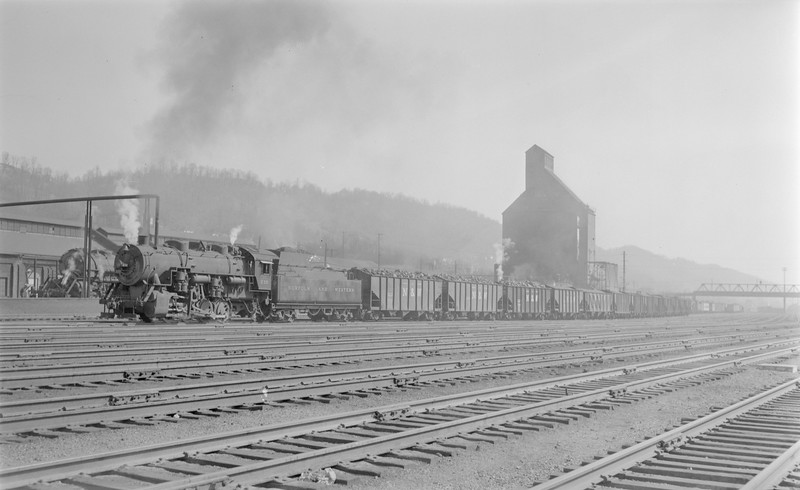 2018.15.N79.6213--ed wilkommen 116 neg--N&W--steam locomotive 0-8-0 S1a 230 switching in yard action--Bluefield WV--1955 0410