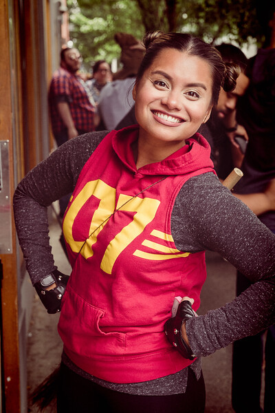 """A young woman, waiting to get into a bar, throws a pose at me. She was there along with many others, dressed in """"Harry Potter"""" story costumes, waiting to get into the bar to watch live bands play out back in the parking lot."""
