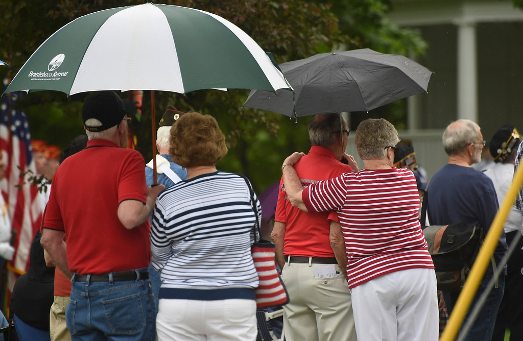 . Kayla Rice/Reformer People gather under umbrellas during the Memorial Day service at the Brattleboro Common on Monday morning.