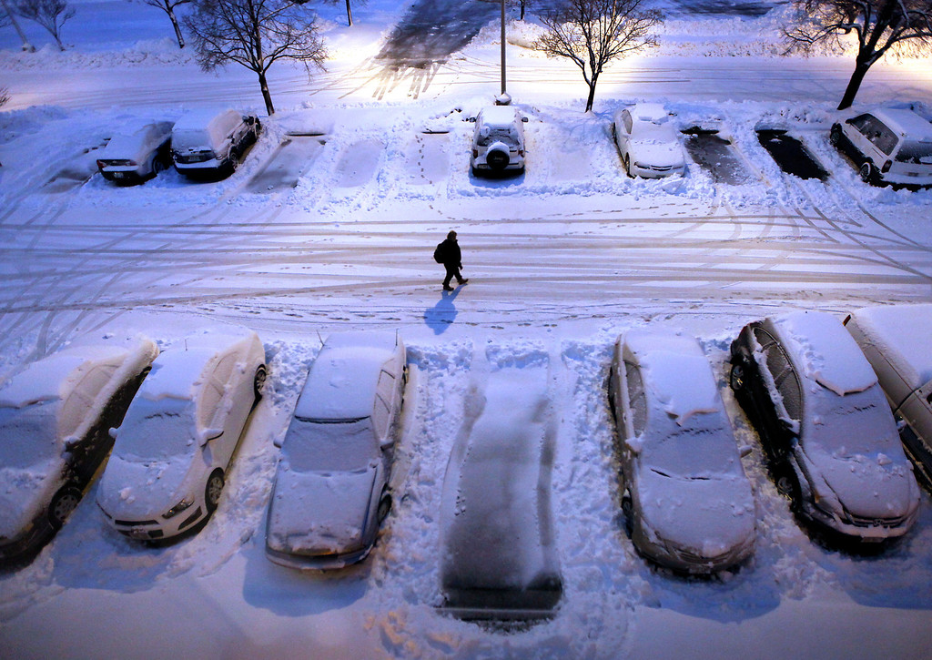 . Snow-covered cars in a parking lot greet early morning risers in Madison, Wis. as a severe winter storm moves through the upper Midwest Thursday, Dec. 20, 2012. (AP Photo/Wisconsin State Journal, John Hart)