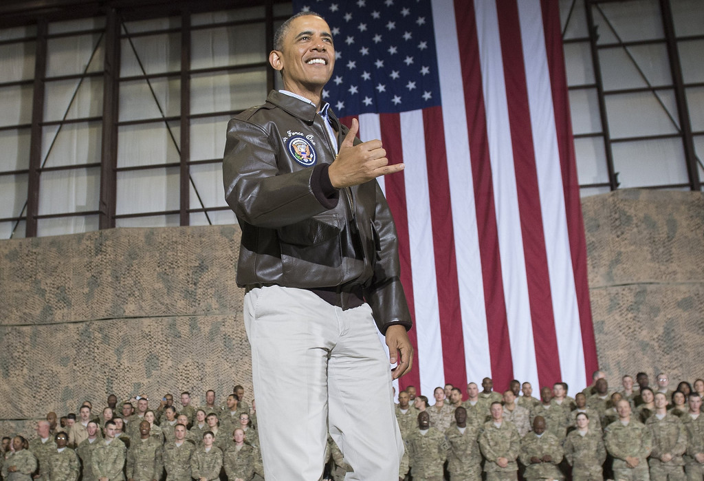 ". US President Barack Obama does a Hawaiian ""shaka\"" as he greets US troops during a surprise visit to Bagram Air Field, north of Kabul, in Afghanistan, May 25, 2014, prior to the Memorial Day holiday.   SAUL LOEB/AFP/Getty Images"