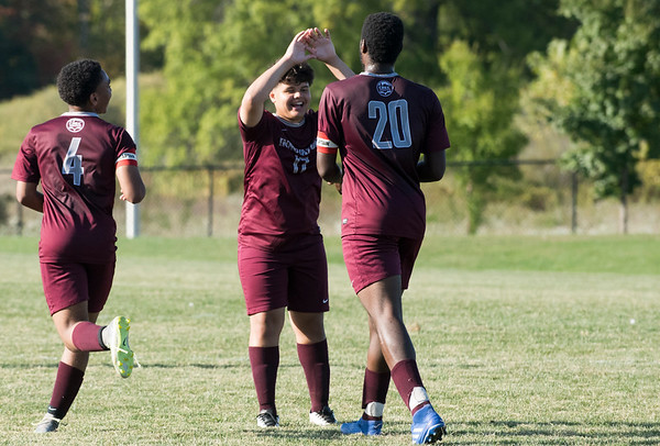 09/30/19 Wesley Bunnell | StaffrrInnovation High School vs Civid Leadership on Monday afternoon at Innovation High School. Clinton Allen (20) is greeted by Adriel Colon (17) after a Clinton goal in the first half.