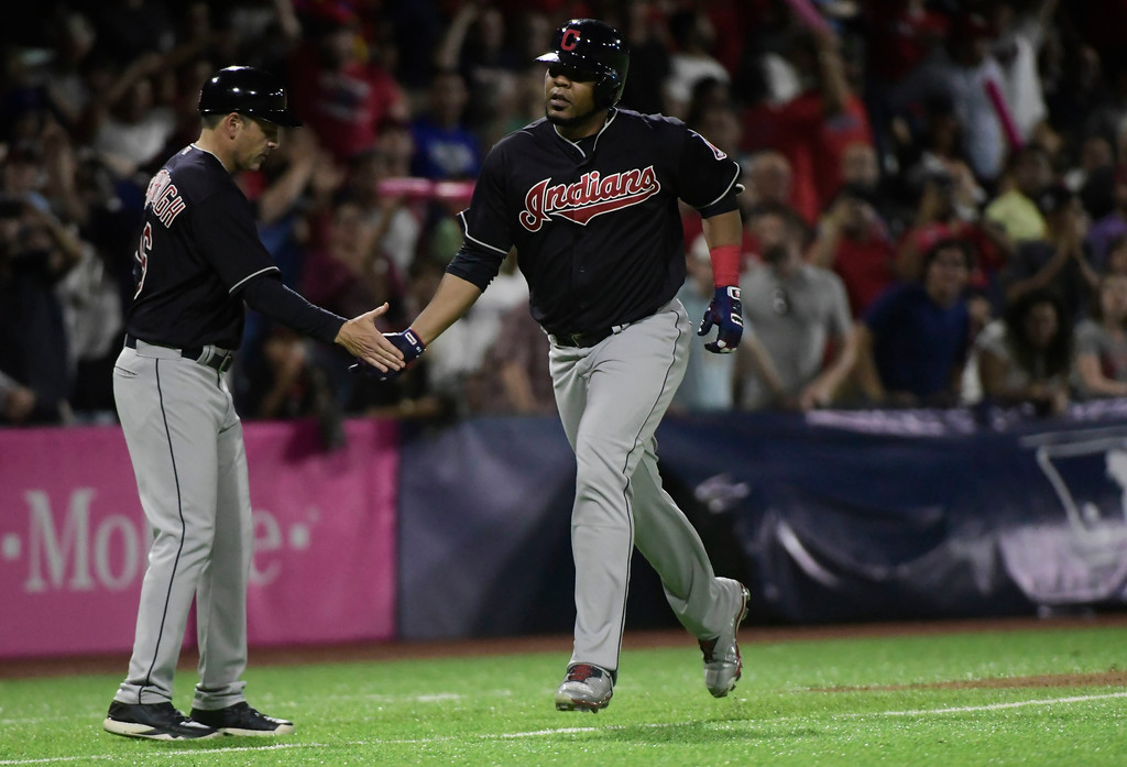 . Cleveland Indian\'s designated hitter Edwin Encarnacion, right, runs the bases after hitting a home run in the fourteenth inning during the final game of a two-game Mayor League Series against the Minnesota Twins at Hiram Bithorn Stadium in San Juan, Puerto Rico, Wednesday, April 18, 2018. (AP Photo/Carlos Giusti)