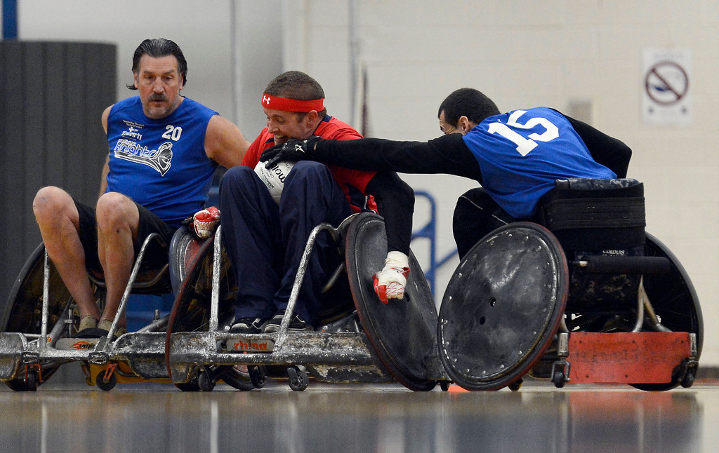 . DENVER, CO. - FEBRUARY 10: Jack Hermosillo (15) of the Northridge Knights reaches in on Matt Gypin (12) of the Denver Harlequins during the Wheelchair Rugby Tournament February 10, 2013 at Englewood High School.  The Mile High Mayhem was put on by Craig Hospital and city of Englewood.(Photo By John Leyba/The Denver Post)