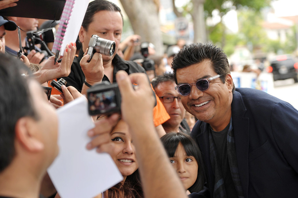 """. Actor George Lopez poses for a photo at the world premiere of \""""The Smurfs 2\"""" at the Regency Village Theatre on Sunday, July 28, 2013 in Los Angeles. (Photo by John Shearer/Invision/AP)"""