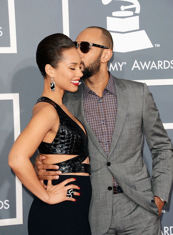 . Singer Alicia Keys (L) and producer Swizz Beatz arrive at the 55th Annual GRAMMY Awards at Staples Center on February 10, 2013 in Los Angeles, California.  (Photo by Jason Merritt/Getty Images)
