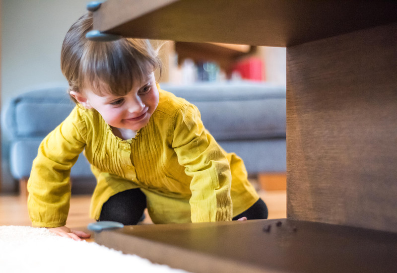 Fred_Home_Safety_Corner_Protector_Lifestyle_girl_under_table_smiling.jpg