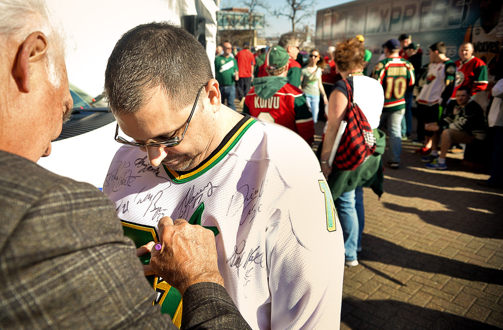 . Bill Dunkel of Maplewood has his North Star Jersey signed by Minnesota hockey legend Lou Nanne, left, outside Xcel Energy Center before the start of Game 3.  (Pioneer Press: Ben Garvin)