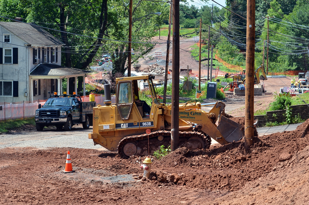 . A trackhoe operator works on a widened section of Cowpath Road near the intersection with Godshall Road and West Broad Street as part of the realignment project that is expected to be completed by November.    Monday, August 4, 2014.   Photo by Geoff Patton