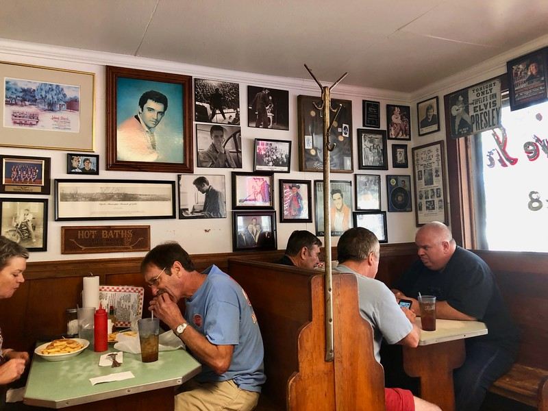 people eating at a diner with elvis memorabilla