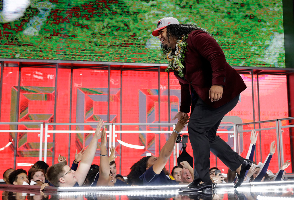 . Washington\'s Vita Vea walks onto the stage after being selected by the Tampa Bay Buccaneers during the first round of the NFL football draft, Thursday, April 26, 2018, in Arlington, Texas. (AP Photo/David J. Phillip)