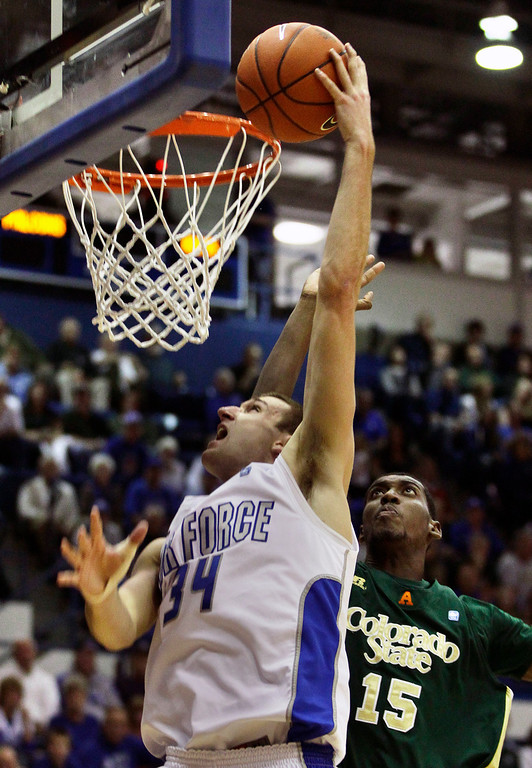 . Air Force\'s Taylor Broekhuis, left, shoots as Colorado State\'s Gerson Santo (15) tries to block during the second half of an NCAA college basketball game in Air Force Academy, Colo., Saturday, Feb. 16, 2013. Colorado State won 89-86. (AP Photo/Brennan Linsley)