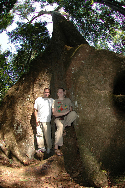 Jon and Cheryl standing next to a really big tree in the Periyar Wildlife Preserve