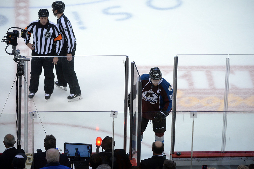 . DENVER, CO - APRIL 26: Gabriel Landeskog (92) of the Colorado Avalanche goes into the penalty box for an unsportsmanlike conduct call against him after he sprayed Minnesota Wild with snow from his skates during the third period. The Colorado Avalanche hosted the Minnesota Wild during game five of the first round of the NHL Stanley Cup Playoffs at the Pepsi Center on Saturday, April 26, 2014. (Photo by Karl Gehring/The Denver Post)