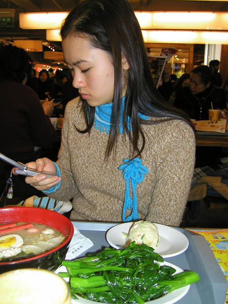 Young lady in a food court having lunch, Beijing, Jan 2004