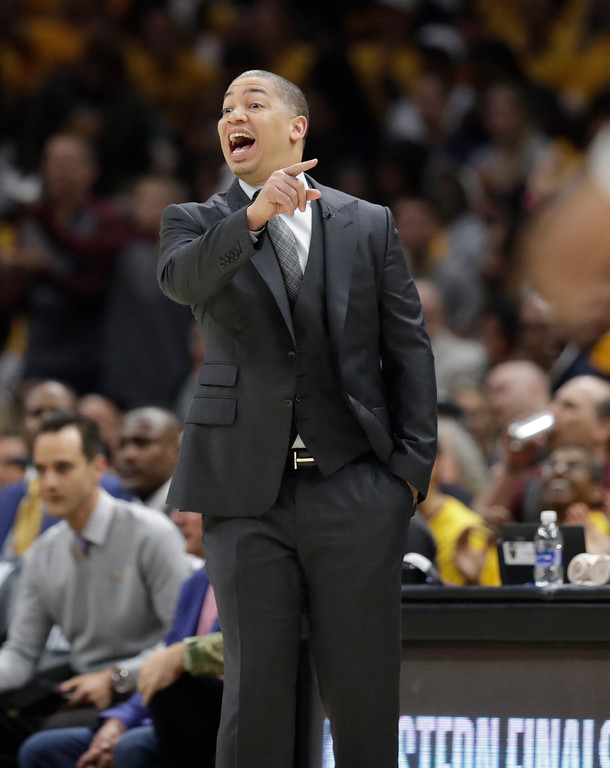 . Cleveland Cavaliers head coach Tyronn Lue calls instructions against the Boston Celtics in the first half of Game 3 of the NBA basketball Eastern Conference finals, Saturday, May 19, 2018, in Cleveland. (AP Photo/Tony Dejak)