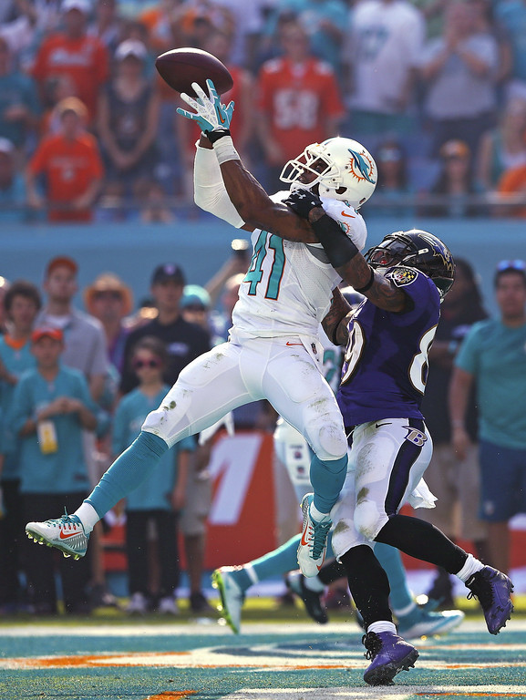 . MIAMI GARDENS, FL - DECEMBER 07:  Defensive back R.J. Stanford #41 of the Miami Dolphins intercepts a second quarter pass in the endzone intended for wide receiver Steve Smith #89 of the Baltimore Ravens during a game at Sun Life Stadium on December 7, 2014 in Miami Gardens, Florida.  (Photo by Mike Ehrmann/Getty Images) *** BESTPIX ***