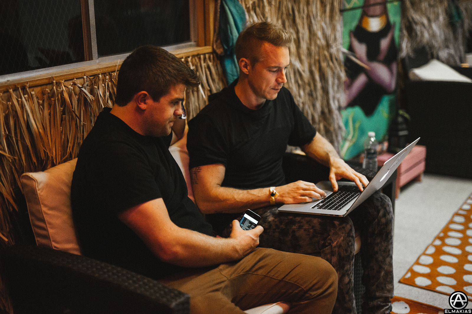 Diplo and his light guy discussion the set he is about to play