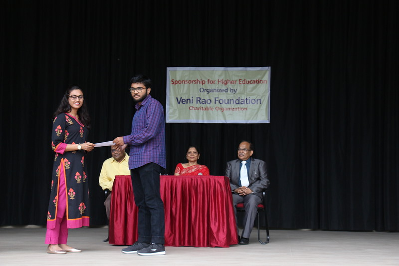 Ms. Nikhila Pinjala giving schloarship cheque to Mr. Faisal Khan.JPG
