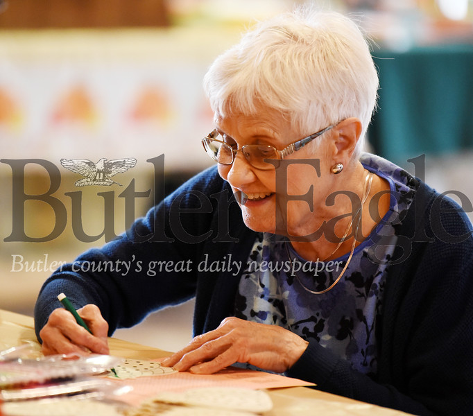 Harold Aughton/Butler Eagle: Dolores Graham, 88, of the Cranberry Twp. Senior Center takes part in the arts and crafts activities during the senior fall festival at Camp Kon-o-Kwee Wed., Oct. 30.