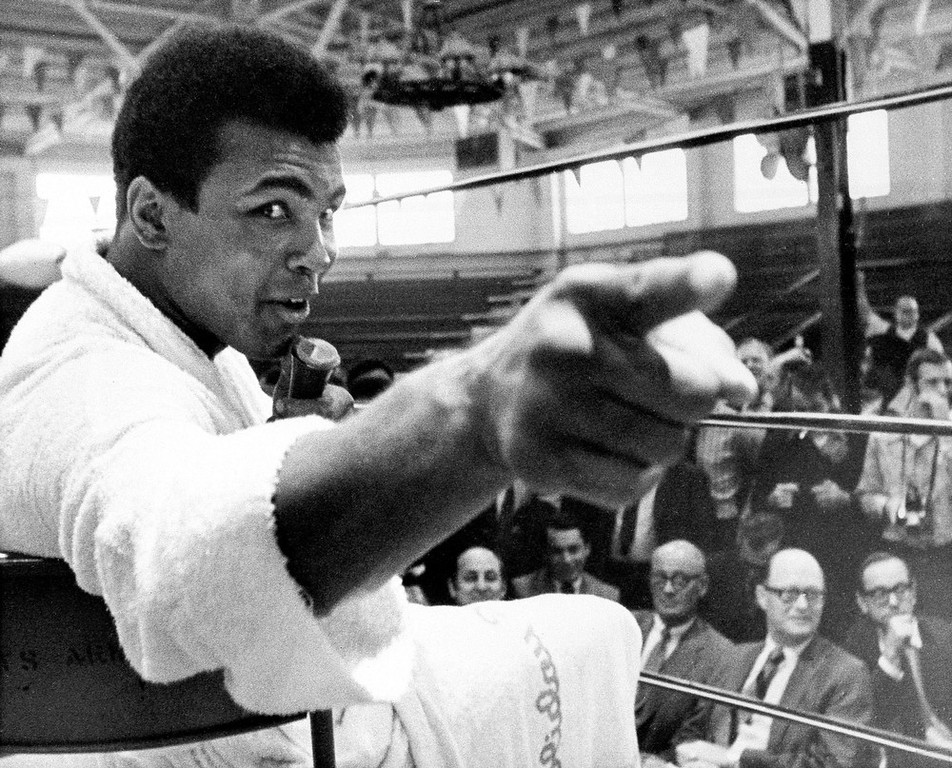 """. Heavyweight boxer Muhammad Ali makes a point during a news conference that he conducts from inside the ring in Atlanta, Ga., in this Oct. 24, 1970, file photo. A new book, \""""Ali Rap: Muhammad Ali the First Heavyweight Champion of Rap,\"""" proclaims Ali\'s verbal barrage was more than self-promotion, but sowed the seeds of hip-hop, which came into being in the `70s.  (AP Photo/FILE)"""