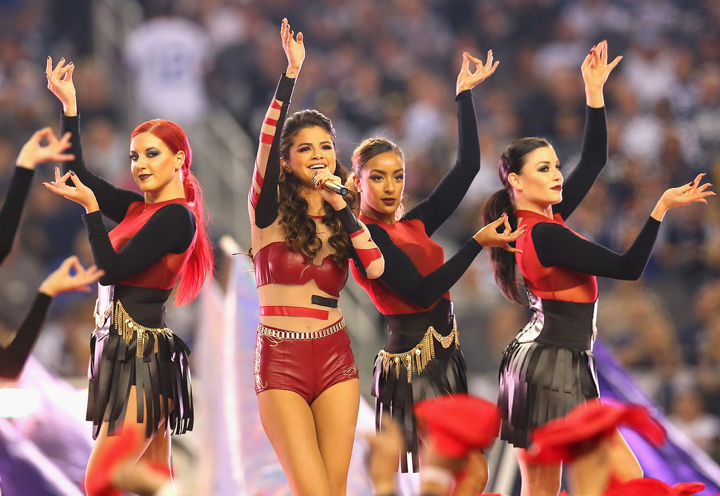 . Selena Gomez performs during the halftime of a Thanksgiving Day game between the Oakland Raiders and the Dallas Cowboys at AT&T Stadium on November 28, 2013 in Arlington, Texas.  (Photo by Ronald Martinez/Getty Images)