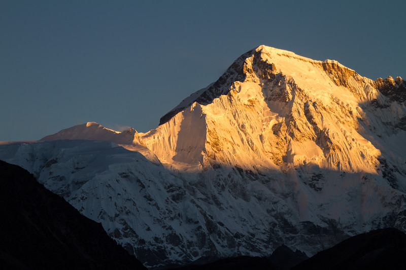 Morning sun lights the glaciated flanks of Cho Oyu, the sixth highest mountain in the world on the Nepal-Tibet (China) border.
