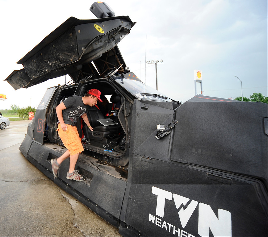 . April 27,2014. Saillisaw OK. USA. Meteorologist and Extreme Storm Chaser Reed Timmer with his 3 storm chase cars called the Dominators, get ready to chase some tornados.